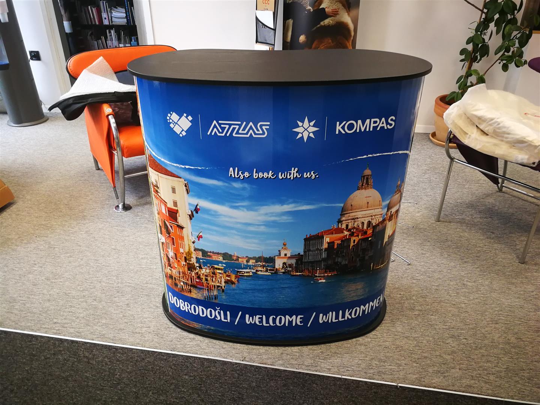 Promo pult - Atlas Kompas